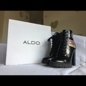 Black ALDO boots with patches on sides